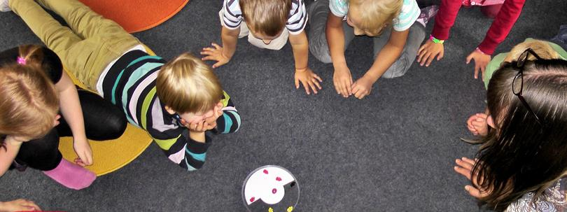 Photo of children laying on the floor